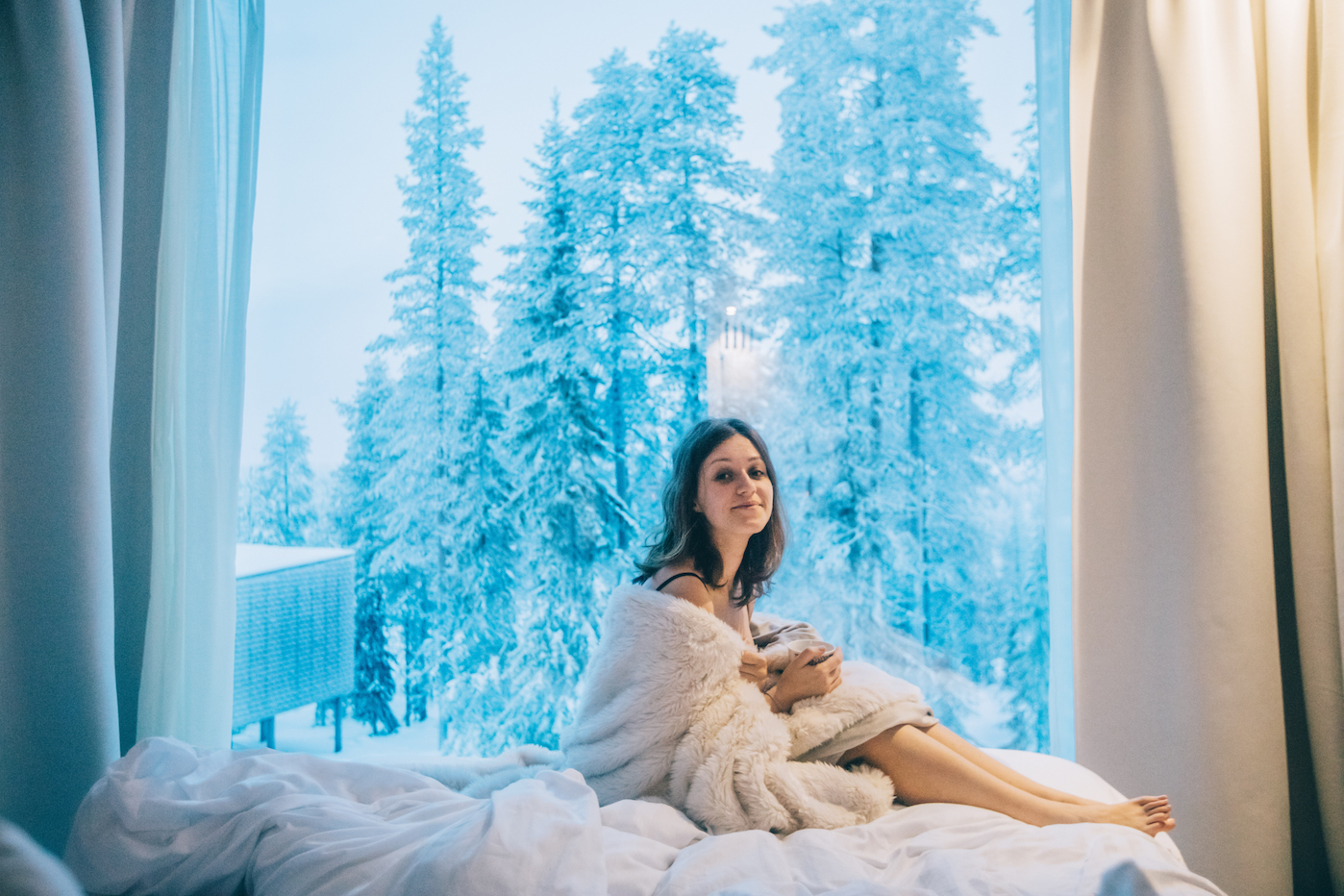 girl, northern lights, arctic treehouse hotel, finland best hotels
